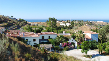 Photo of all buildings of the Finca from the hill with the Mediterranean Sea in the background